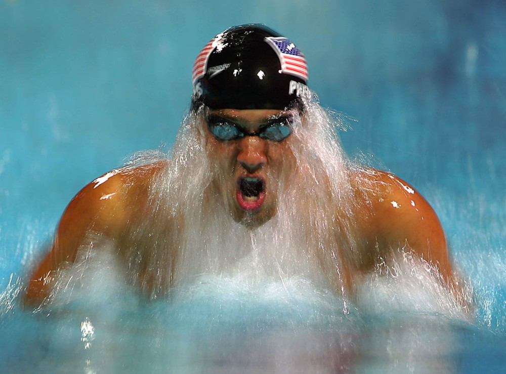 ATHENS - AUGUST 19:  Michael Phelps of USA competes in the men's swimming 200 metre individual medley final on August 19, 2004 during the Athens 2004 Summer Olympic Games at the Main Pool of the Olympic Sports Complex Aquatic Centre in Athens, Greece. (Photo by Al Bello/Getty Images) *** Local Caption *** Michael Phelps
